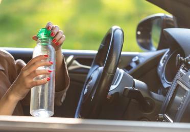avoid leaving your plastic water bottle in your car to prevent bacterial & chemical poisoning