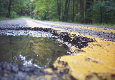 to maintain a healthy car suspension & steering system, avoid slamming into a pothole